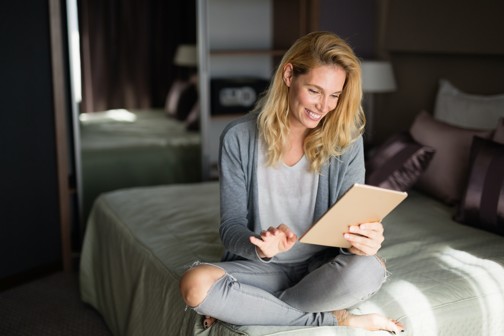 Blond woman using tablet