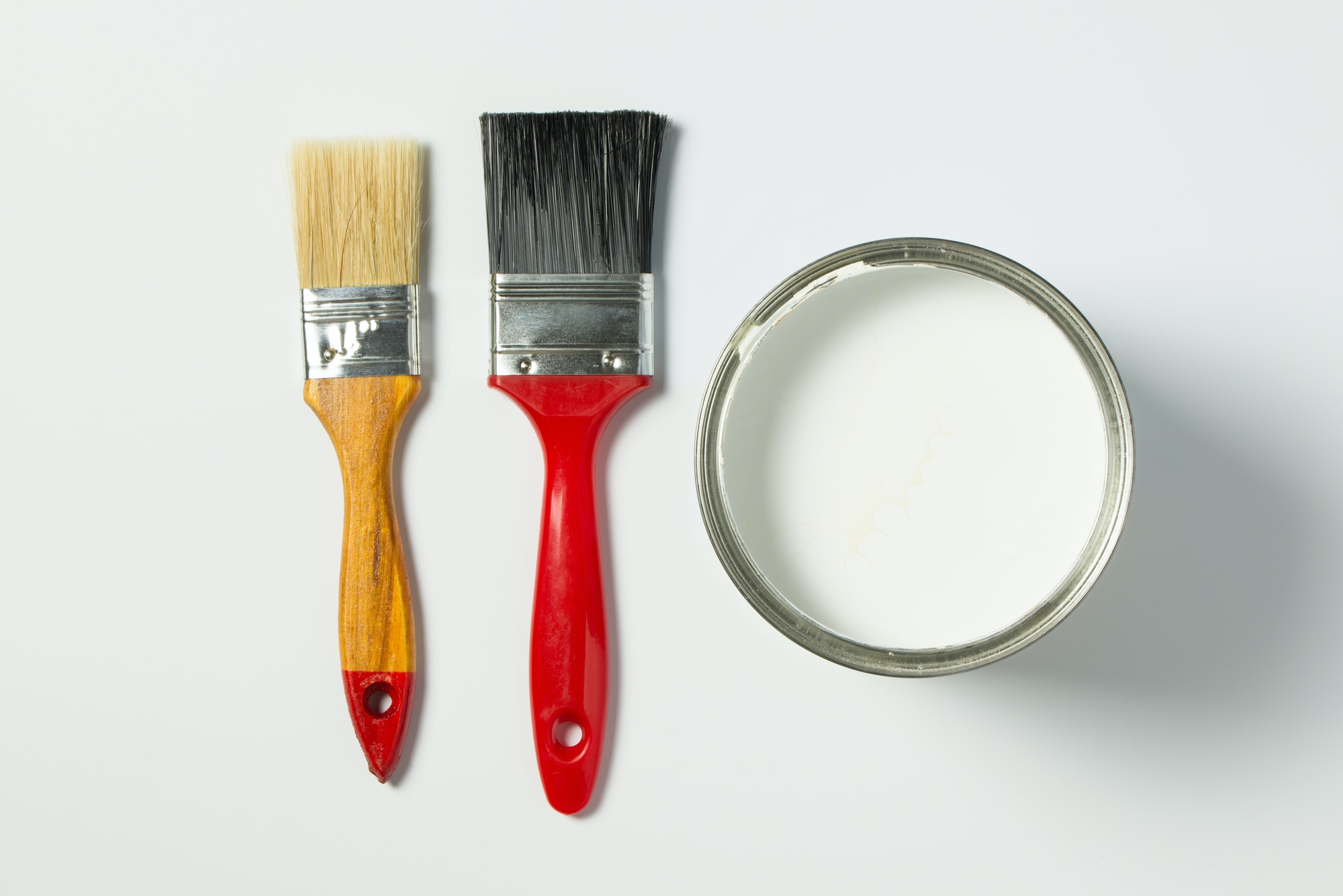 White paint and paint brushes